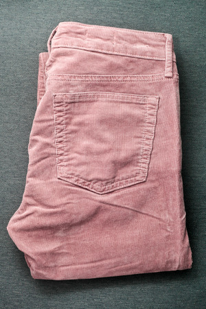 corduroy: Folded pair of pink corduroy trousers Stock Photo