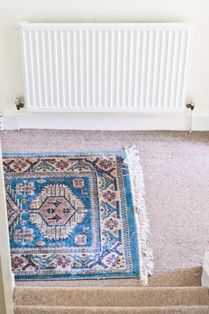 oriental rug: Part of a blue oriental rug in a home hallway Stock Photo
