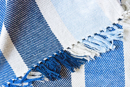 soft furnishing: Part of a blue and white blanket