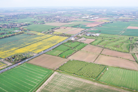 cambridgeshire: Rural Cambridgeshire from above with A14 trunk road and Hemingford Grey in the centre of the image Stock Photo