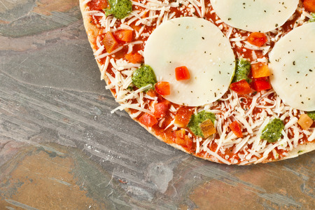 stone worktop: Fresh pizza ready for cooking on a stone surface