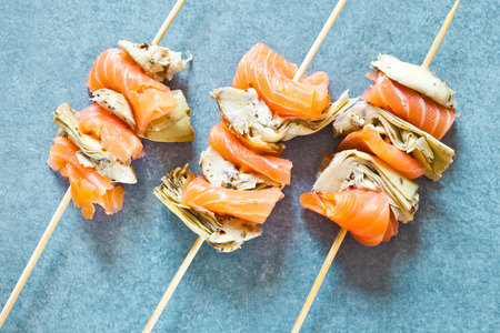 Smoked salmon and grilled artichoke kebabs Stock Photo