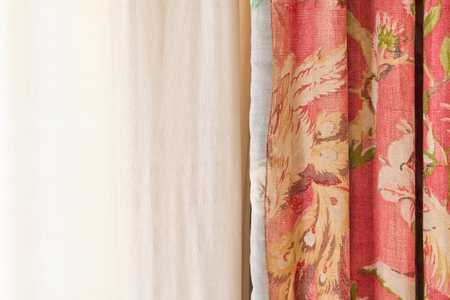 soft furnishing: Floral curtain and a line drape in a house