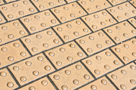 tactile: Paving with tactile bumps for aiding blind people