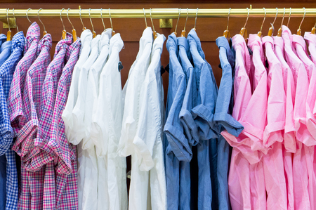 short sleeved: Stlish casual mens short sleeved shirts hanging in a store