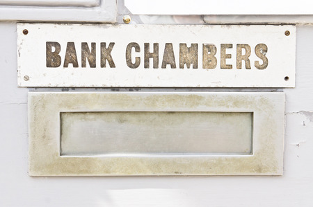 Letter box with sign saying bank chambers photo