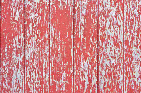 A weathered red painted wooden surface as a background photo