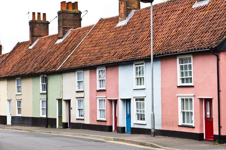 neighbours: Row of colorful small cottages in Diss, England Stock Photo