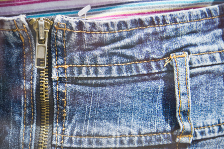 denim skirt: Close up of the zip of a denim skirt