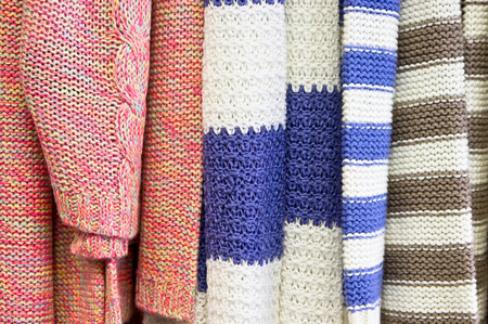 jumpers: Close up of colorful wool jumpers in a store