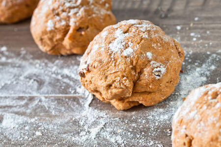worktop: Balls of wholemeal dough rising on a kitchen worktop Stock Photo