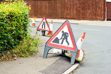 roadworks: Signs for roadworks in a suburban street