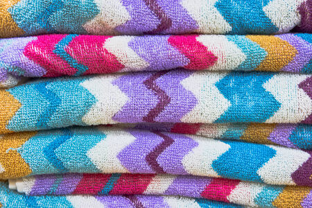 Stack of vibrant new towels as a background Stock Photo