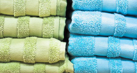 Stacks of blue and green towels Stock Photo