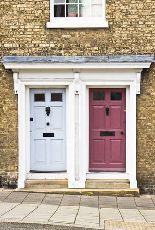 neighboring: Blue and maroon neighboring front doors Stock Photo