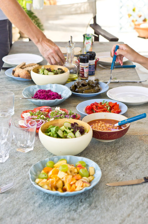 Various dishes on an outside dining tabke photo