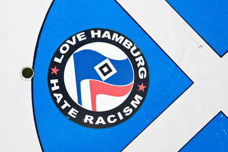 ALONISSON, GREECE - AUGUST 10, 2014: A sticker from a German movement against racism on a suface in Alonissos, Greece.