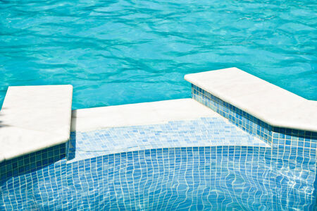 inground: Esdge of swimming pool with blue tiles