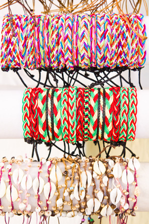 cuff bracelet: Colorful wrist bands on sale at a market Stock Photo