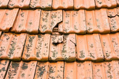 Broken terracotta tile on a roof