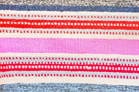 Colorful rug in detail as a background photo