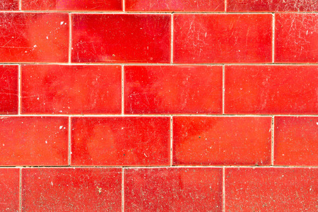 tiled wall: A weathered red tiled wall as a background Stock Photo