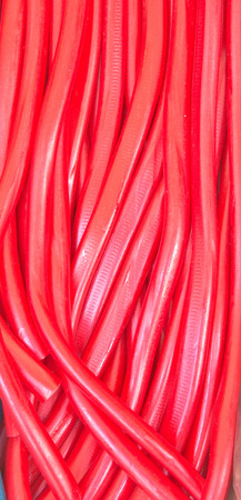 chewy: Red chewy strawberry laces as a background image