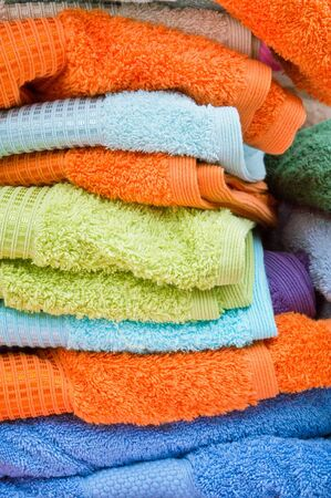 towelling: Stack of colorful towels at a market stall