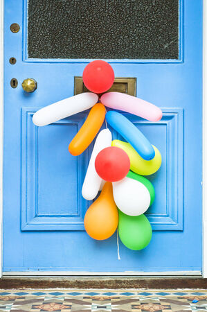 childs birthday party: Colorful party balloons on a front door Stock Photo