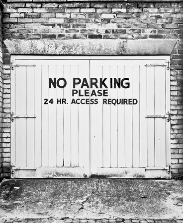 no  parking: No parking sign on a garage door