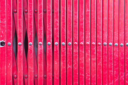 expanding: Close up expanding red metal bars as an abstract