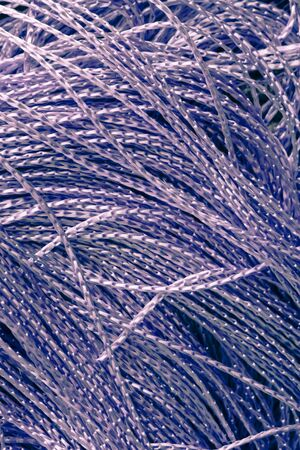 innate: Close up of purple string as a background image