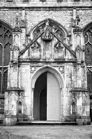 half open: A half open double door in an old english church