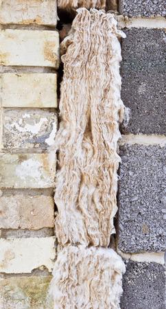coping: Cavity wall insulation in progress