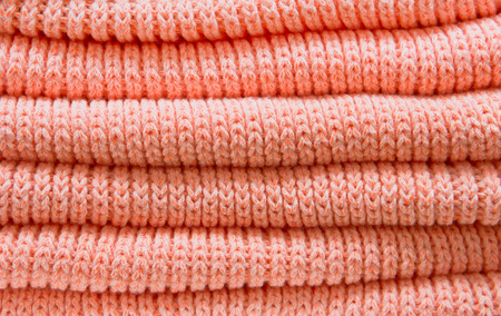 jumpers: Pile of folded orange wool jumpers