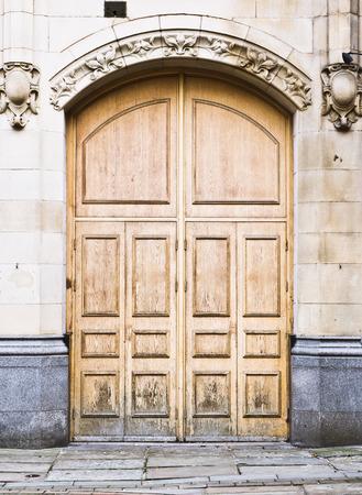 doorway: A large wooden arch doorway