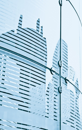 Glass panels on a modern building with details of the reinforcing structures Stock Photo