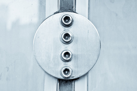 rubber sealant: Metal bolts reinforcing the seal of adjacent glass panels Stock Photo