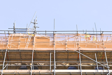 work worker workforce world: Scaffolding at a construction site Stock Photo