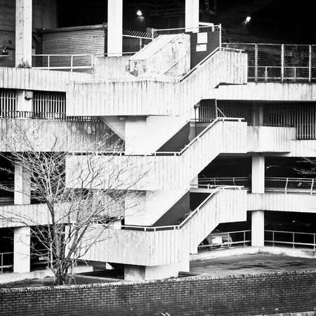 sidewall: Spiral stone staircase on the edge of a multi-storey car park