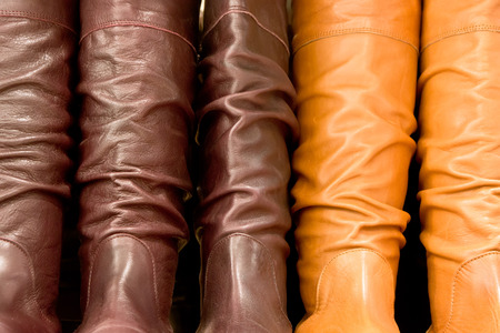 Row of leather boots as a background