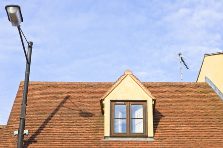 attic room: An attic room window in the roof of a house