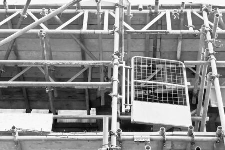 work worker workforce world: Details of scaffolding bars on a building