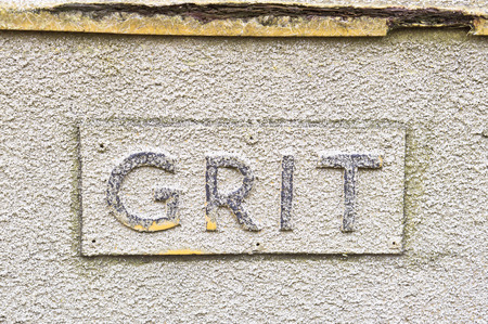 Sign on a crate of grit for the roads in winter