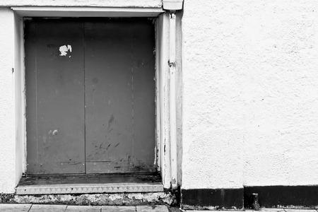 backdoor: A closed door in an urban building