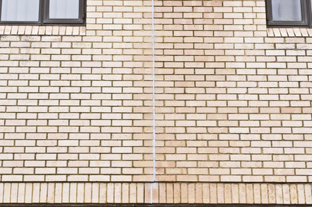 sealant: Vertical line of sealant on an external brick wall