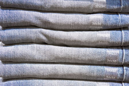 trousers: Pile of folded denim trousers