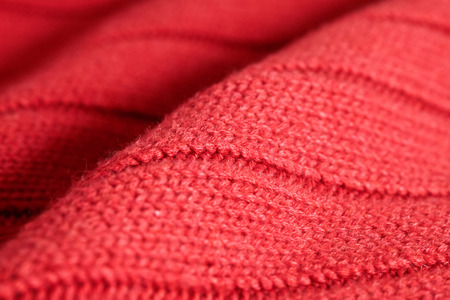 knitwear: Close up of folded red wool knitwear