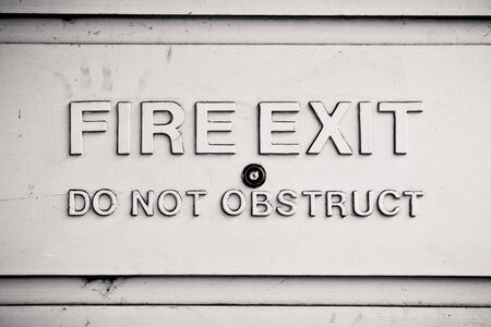 fire exit sign: Embossed stone fire exit sign