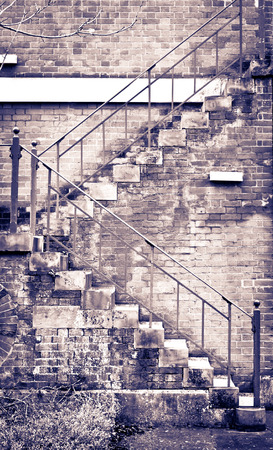 fire brick: External fire escape stairs on a red brick building in the UK